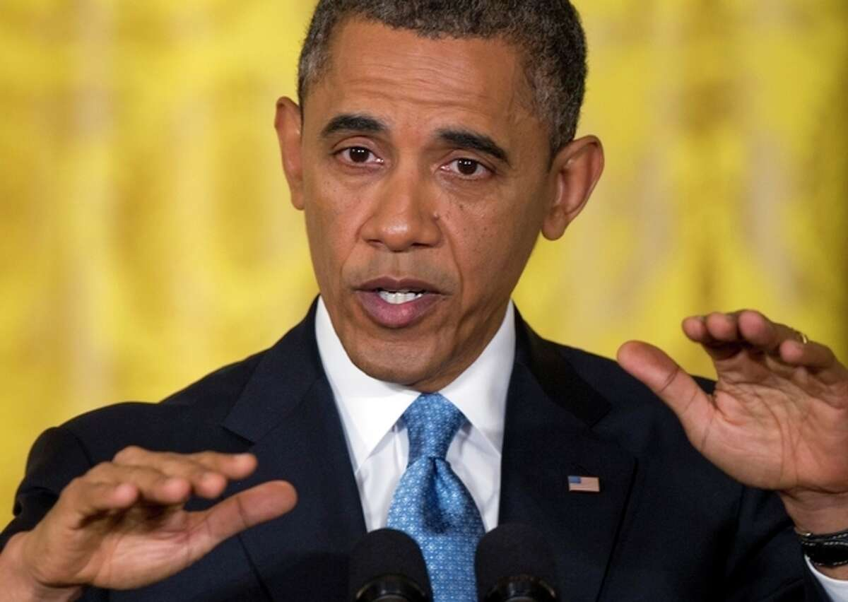 President Barack Obama gestures as he speaks during the last news conference of his first term in the East Room of the White House in Washington, Monday, Jan. 14, 2013. (AP Photo/Carolyn Kaster)