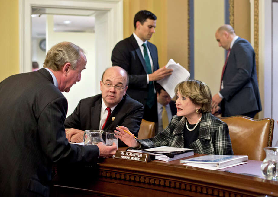Rep. Rodney Frelinghuysen, R-N.J., left, confers with Rep. Louise Slaughter, D-N.Y., Rep. Jim McGovern, D-Mass., center, as the House Rules Committee sorts through dozens of amendments on an aid package to assist victims of Superstorm Sandy that devastated parts of the Northeast coast in October, at the Capitol in Washington, Monday, Jan. 14, 2013. The House is expected to vote on the bill Tuesday. (AP Photo/J. Scott Applewhite) / AP