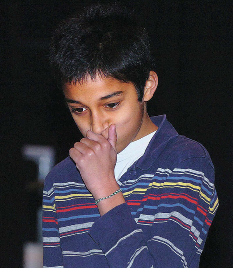 Hour Photo Alex von Kleydorff; 6th grader Pramukh Nadig thinks before he answers a question during Nathan Hale Middle School's Geography Bee. / 2013 The Hour Newspapers