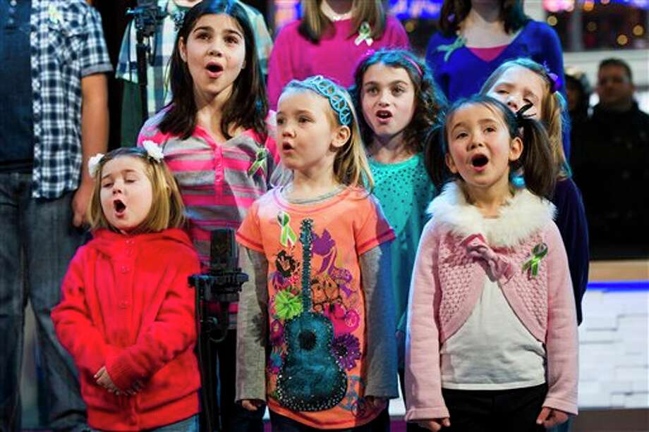"""Children from Newtown, Conn. and Sandy Hook Elementary school perform """"Somewhere Over the Rainbow"""" on ABC's """"Good Morning America"""" on Tuesday, Jan. 15, 2013 in New York. The Children who survived last month's shooting rampage, recorded a version of """"Over the Rainbow"""" to raise money for charity. They recorded the song at the home of two former members of the Talking Heads rock band. It went on sale Tuesday on Amazon and iTunes, with proceeds benefiting a local United Way and the Newtown Youth Academy. (Photo by Charles Sykes/Invision/AP) / Invision"""