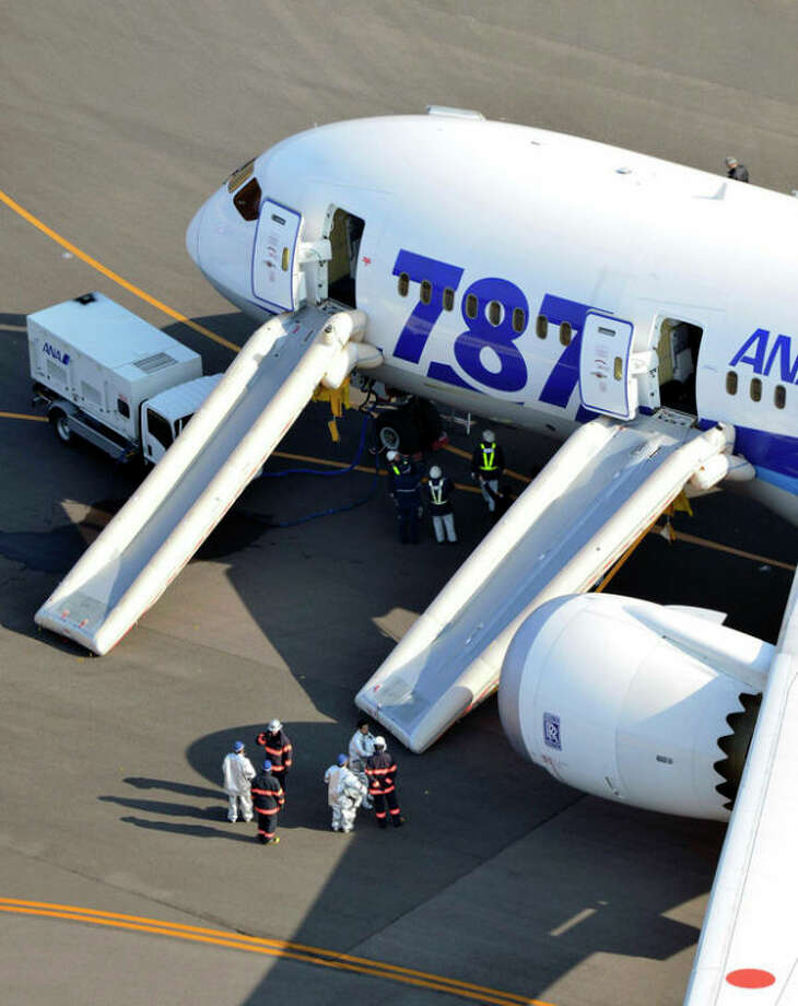 """An All Nippon Airways flight sits at Takamatsu airport in Takamatsu, western Japan after it made an emergency landing Wednesday, Jan. 16, 2013. The flight to Tokyo from Ube in western Japan landed at the airport after a cockpit message showed battery problems, in the latest trouble for the Boeing 787 """"Dreamliner."""" (AP Photo/Yomiuri Shimbun, Yasufumi Nagao) JAPAN OUT, MANDATORY CREDIT / Yomiuri Shimbun"""