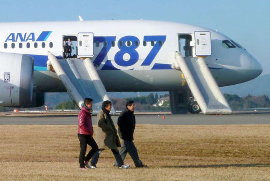 / An ANA flight passenger via Kyodo News