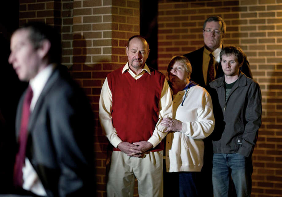 Randy Parker, rear left, stands with his wife Karen as their son, Robbie Parker, left, the father of six-year-old Emilie who was killed in the Sandy Hook Elementary School shooting, speaks at a news conference outside the Church of Jesus Christ of Latter Day Saints, Saturday, Dec. 15, 2012, in Newtown, Conn. (AP Photo/David Goldman) / AP