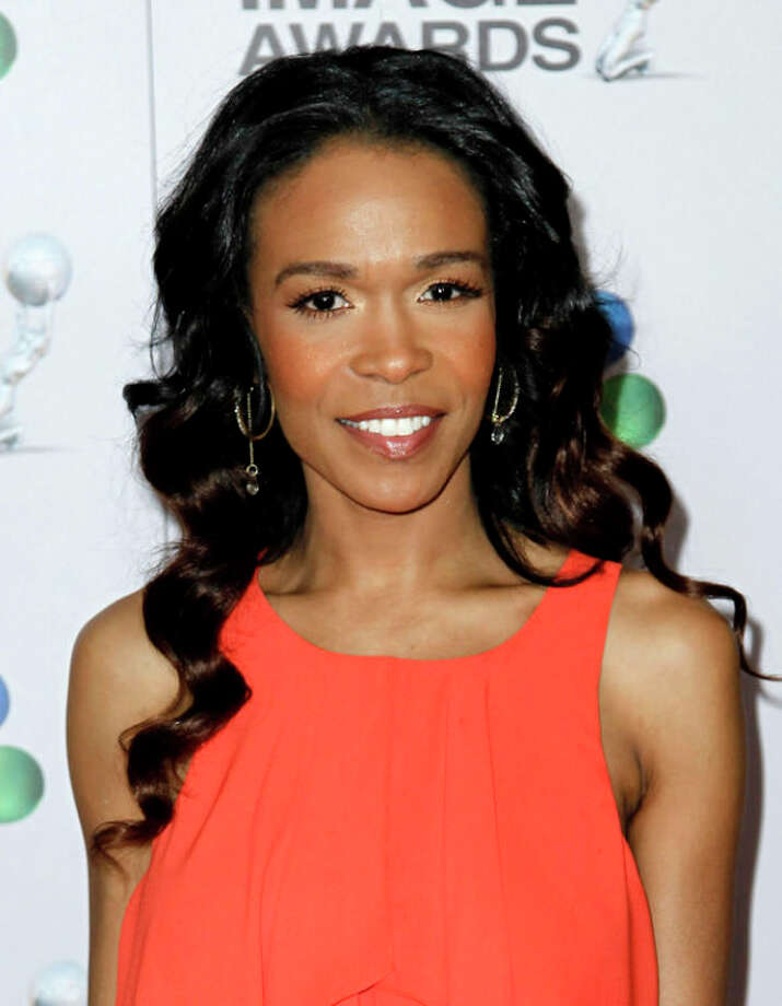 "FILE - This Feb. 17, 2012 file photo shows singer-actress Michelle Williams at the 43rd NAACP Image Awards in Los Angeles. Williams is joining the latest national tour of the musical ""Fela!"" Producers said Thursday, Jan. 3, 2013, the singer who starred on the UPN sitcom ""Half & Half"" will be onstage when the tour opens at Sidney Harman Hall in Washington, D.C., on Jan. 29. Williams, part of Destiny's Child along with Kelly Rowland and Beyonce, is now solo artist who released the dance album ""Unexpected"" and the single ""On The Run."" (AP Photo/Matt Sayles, file) / AP"