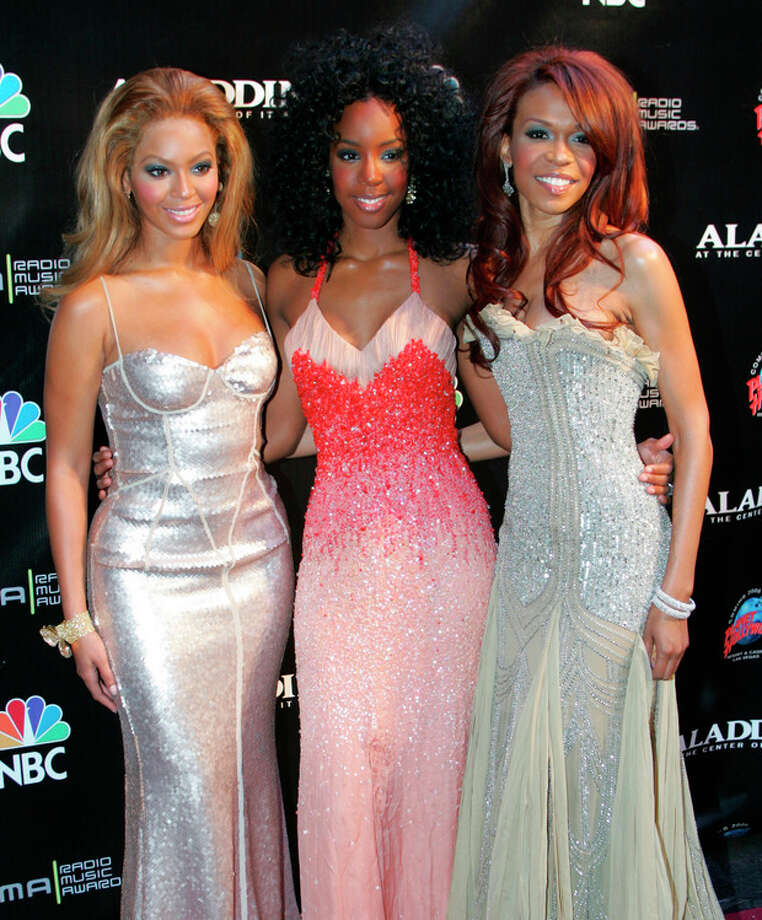 FILE - This Oct. 25, 2004 file photo shows members of Destiny's Child, from left, Beyonce Knowles, Kelly Rowland and Michelle Williams at the Radio Music Awards in Las Vegas. The singer-actress _ one third of Destiny's Child alongside Beyonce and Kelly Rowland _ said that in the past few months she has emerged from years of suffering from moderate depression. Her dark cloud lifted thanks to exercise, therapy and positive thinking. (AP Photo/Eric Jamison, file) / A-JAMISON