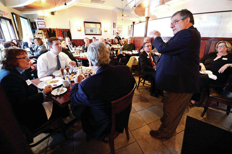 Hour photo / Erik TrautmannWebster Bank Chief Economist NIcholas Perna gives his economic forecast at Marley's Diner as part of the Eggs and the Economy breakfast sponsored by the Wilton Chamber of Commerce Thursday morning. / (C)2012, The Hour Newspapers, all rights reserved