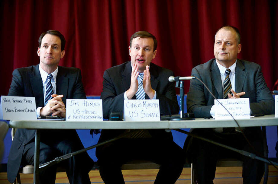 U.S. Congressman Jim Himes and U.S. Senator Chris Murphy hold a roundtable discussion on reducing gun violence in America with other local officials including Stamford Director of Public Safety, Ted Jankowski, at Stamford's Yearwood Center Thursday. Hour photo / Erik Trautmann