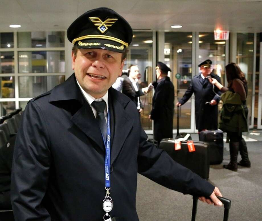 Polish Airlines Captain Stanislaw Radzio talks about the flight of LOT flight 003 from Warsaw, a Boeing 787, after their arrival at Chicago's O'Hare International Airport Wednesday, Jan. 16, 2013. The FAA grounded all Boeing 787 Dreamliner airplanes pending safety checks of the planes lithium batteries and passengers ticketed on the return flight to Warsaw were rebooked on other airlines. (AP Photo/Charles Rex Arbogast) / AP
