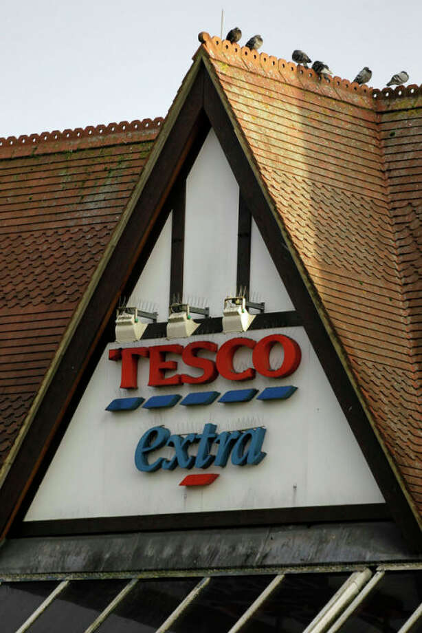 "A sign of Tesco supermarket is seen at a branch in Purley, south London, Wednesday, Jan. 16, 2013. The Irish food safety watchdog said Tuesday that it had discovered traces of horse and pig DNA in burger products sold by some of the country's biggest supermarkets. Tesco that authorities said was made of roughly 30 percent horse. Tesco, the country's biggest supermarket chain, took out full-page newspaper ads Thursday Jan. 17, 2013 to apologize for an unwanted ingredient in some of its hamburgers: horsemeat. Ten million burgers have been taken off shop shelves after the revelation that beef products from three companies in Ireland and Britain contained horse DNA. Most had only small traces, but one type of burger sold by Tesco was 29 percent horse. The contrite grocer told customers that ""we and our supplier have let you down and we apologize."" (AP Photo/Sang Tan) / AP"