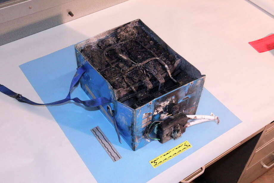 This undated image provided by the National Transportation Safety Board shows the burned auxiliary power unit battery from a JAL Boeing 787 that caught fire on Jan. 7, 2013, at Boston's Logan International Airport. Federal officials said on Wednesday, Jan. 16, 2013, that they are temporarily grounding Boeing's 787 Dreamliners until the risk of possible battery fires is addressed. (AP Photo/National Transportation Safety Board) / National Transportation Safety Board