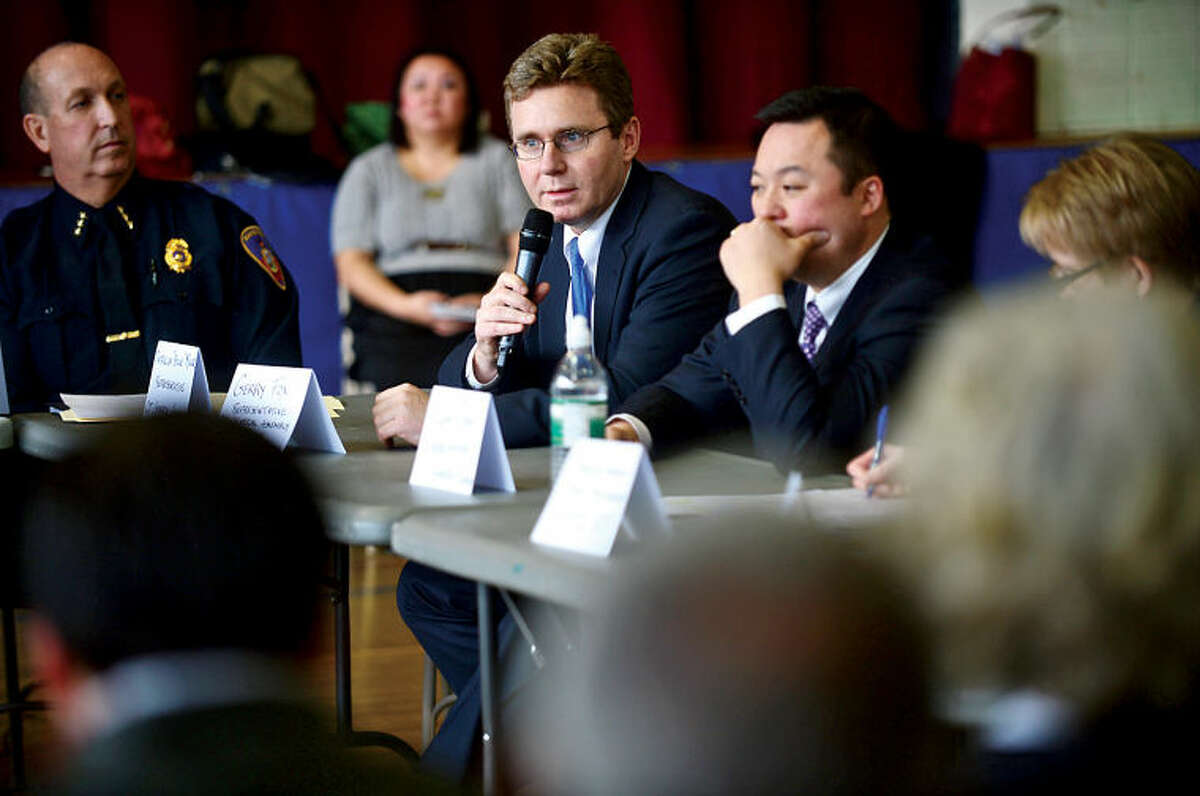 State Representatives Gerry Fox and William Tong join U.S. Congressman Jim Himes and U.S. Senator Chris Murphy as they hold a roundtable discussion on reducing gun violence in America with other local officials at Stamford's Yearwood Center Thursday. Hour photo / Erik Trautmann