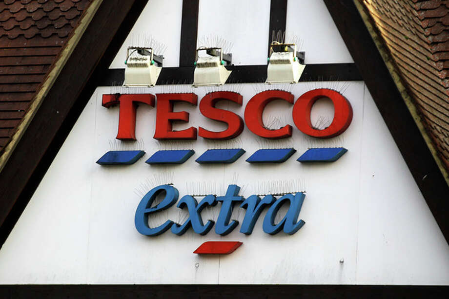 """A sign of Tesco supermarket is seen at a branch in Purley, south London, Wednesday, Jan. 16, 2013. The Irish food safety watchdog said Tuesday that it had discovered traces of horse and pig DNA in burger products sold by some of the country's biggest supermarkets. Tesco that authorities said was made of roughly 30 percent horse. Tesco, the country's biggest supermarket chain, took out full-page newspaper ads Thursday Jan. 17, 2013 to apologize for an unwanted ingredient in some of its hamburgers: horsemeat. Ten million burgers have been taken off shop shelves after the revelation that beef products from three companies in Ireland and Britain contained horse DNA. Most had only small traces, but one type of burger sold by Tesco was 29 percent horse. The contrite grocer told customers that """"we and our supplier have let you down and we apologize."""" (AP Photo/Sang Tan) / AP"""