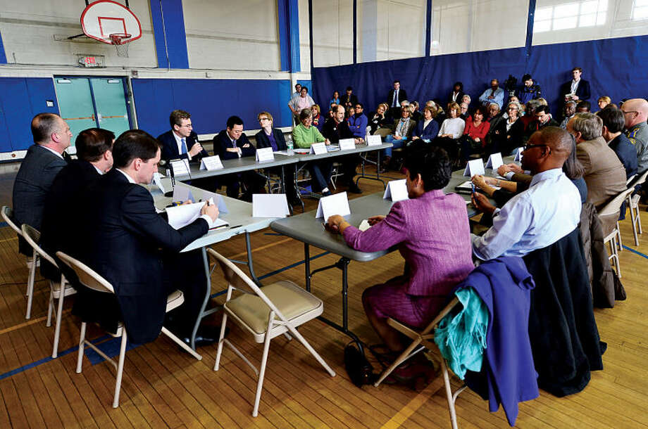 U.S. Congressman Jim Himes and U.S. Senator Chris Murphy hold a roundtable discussion on reducing gun violence in America with other local officials at Stamford's Yearwood Center Thursday. Hour photo / Erik Trautmann
