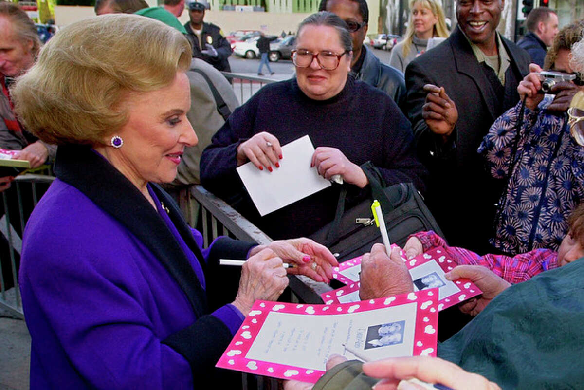 """FILE - In this Feb. 14, 2001 file photo, """"Dear Abby"""" advice columnist Pauline Friedman Phillips, 82, known to millions of readers as Abigail van Buren, signs autographs for some of dozens of fans after the dedication of a """"Dear Abby"""" star on the Hollywood Walk of Fame in Los Angeles. Phillips, who had Alzheimer?'s disease, died Wednesday, Jan. 16, 2013, she was 94. Phillips' column competed for decades with the advice column of Ann Landers, written by her twin sister, Esther Friedman Lederer. Their relationship was stormy in their early adult years, but later they regained the close relationship they had growing up in Sioux City, Iowa. The two columns differed in style. Ann Landers responded to questioners with homey, detailed advice. Abby's replies were often flippant one-liners. (AP Photo/Reed Saxon)"""