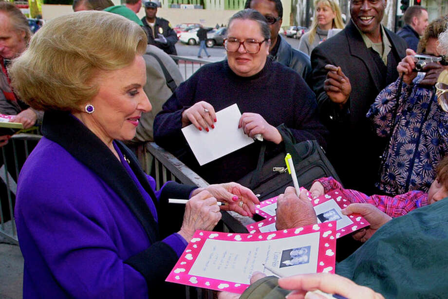 "FILE - In this Feb. 14, 2001 file photo, ""Dear Abby"" advice columnist Pauline Friedman Phillips, 82, known to millions of readers as Abigail van Buren, signs autographs for some of dozens of fans after the dedication of a ""Dear Abby"" star on the Hollywood Walk of Fame in Los Angeles. Phillips, who had Alzheimer's disease, died Wednesday, Jan. 16, 2013, she was 94. Phillips' column competed for decades with the advice column of Ann Landers, written by her twin sister, Esther Friedman Lederer. Their relationship was stormy in their early adult years, but later they regained the close relationship they had growing up in Sioux City, Iowa. The two columns differed in style. Ann Landers responded to questioners with homey, detailed advice. Abby's replies were often flippant one-liners. (AP Photo/Reed Saxon) / AP"