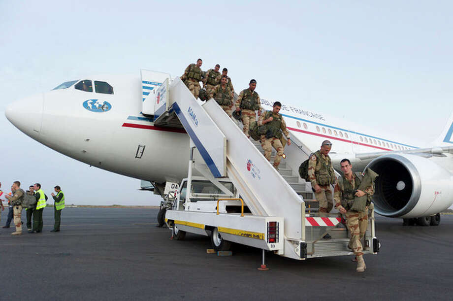 "In this picture dated Sunday, Jan. 13, 2013 and released by the French Army Communications Audiovisual office (ECPAD) French soldiers of the 21st Marine Infantry Regiment based in Frejus, southern France, exit a plane at Bamako airport, Mali. An official at France's Defense Ministry says the country will ""gradually deploy"" a total of 2,500 troops to Mali, and the French president says the military operation will last until security has been restored and African forces are ready to take charge. (AP Photo/Jeremy Lempin, ECPAD) / ECPAD"