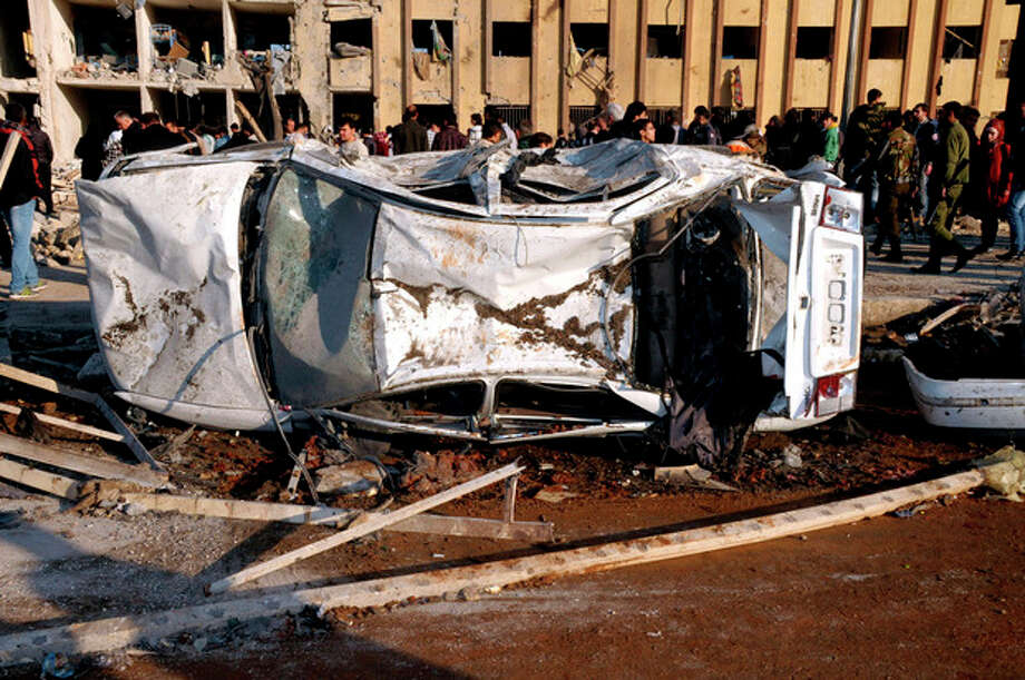 In this photo released by the Syrian official news agency SANA, Syrian people gather at the site after an explosion hit a university in Aleppo, Syria, Tuesday, Jan. 15, 2013. Two explosions struck the main university in the northern Syrian city of Aleppo on Tuesday, causing an unknown number of casualties, state media and anti-government activists said. There were conflicting reports as to what caused the blast at Aleppo University, which was in session Tuesday. (AP Photo/SANA) / SANA