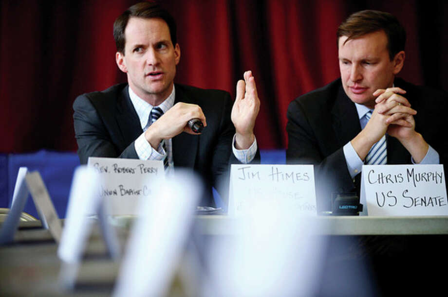 Hour photo / Erik TrautmannU.S. Congressman Jim Himes and U.S. Sen. Chris Murphy, D-Conn., hold a roundtable discussion on reducing gun violence in America with other local officials at Stamford's Yearwood Center. / (C)2012, The Hour Newspapers, all rights reserved
