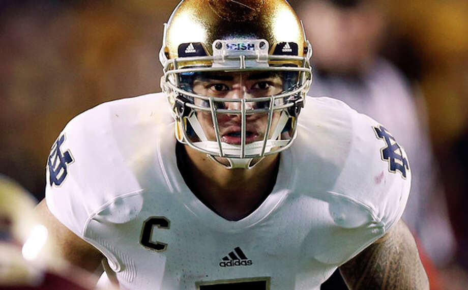 FILE - In this Nov. 10, 2012, file photo, Notre Dame linebacker Manti Te'o waits for the snap during the second half of their NCAA college football game against Boston College in Boston. A story that Te'o's girlfriend had died of leukemia _ a loss he said inspired him to help lead the Irish to the BCS championship game _ was dismissed by the university Wednesday, Jan. 16, 2013, as a hoax perpetrated against the linebacker. (AP Photo/Winslow Townson, File) / FR170221 AP