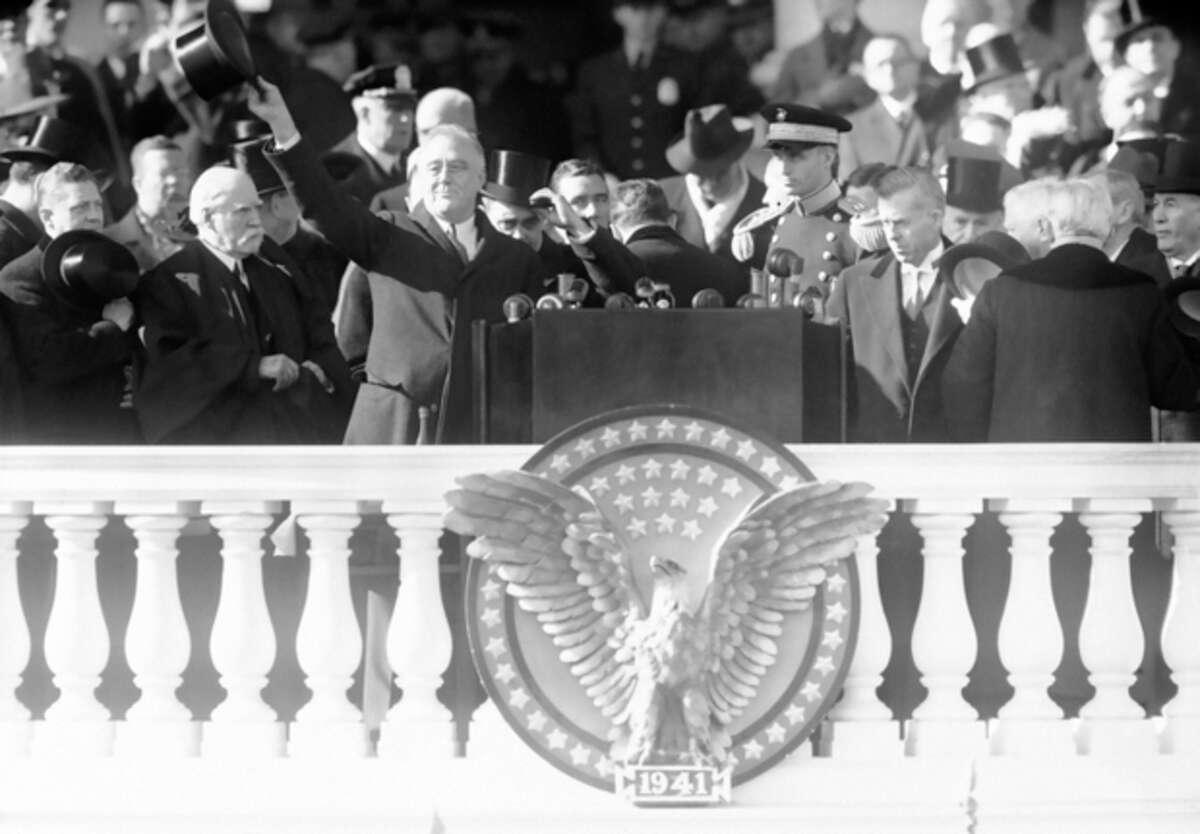 FILE - This Jan. 20, 1941 black-and-white file photo shows President Franklin Delano Roosevelt waving from the inaugural stand on Capitol Hill in Washington. Sixteen presidents before Barack Obama got a second chance at giving an inaugural address for the ages. Most didn?'t make much of it. Abraham Lincoln is the grand exception. (AP Photo, File)