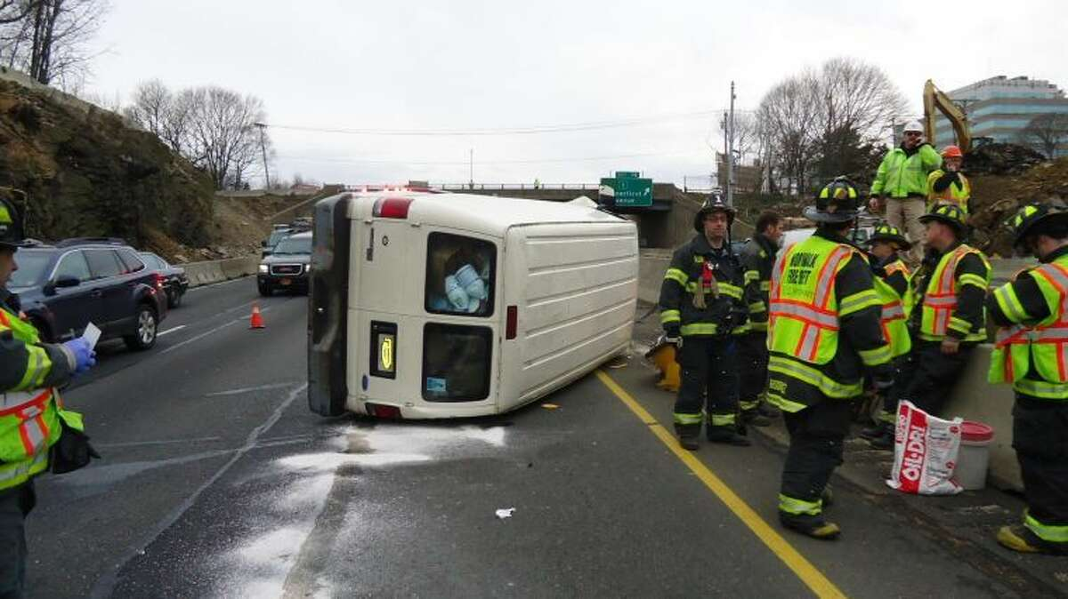 Contributed photo Emergency personnel respond to rollover on I-95 in Norwalk on Tuesday, Jan. 15.