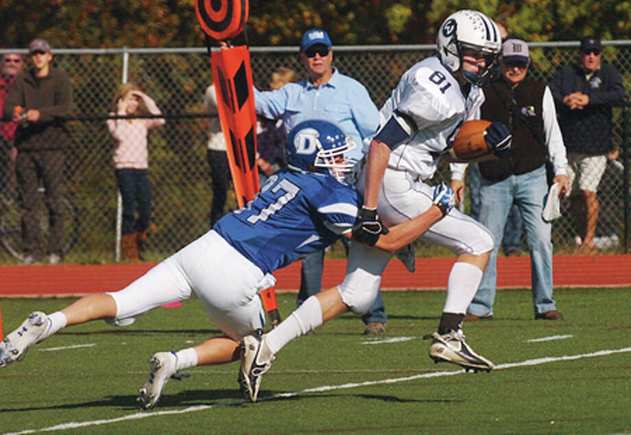 #81 for Wilton heads for the endzone after shedding a tackler during their game against Darien Saturday. Hour photo / Erik Trautmann / (C)2011, The Hour Newspapers, all rights reserved