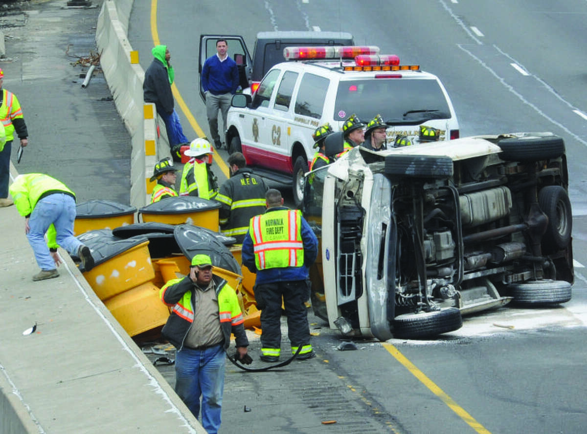 A rollover involving a van at exit 14 on I-95 in Norwalk at around 2:00 Tuesday, Jan. 15. hour photo/Matthew Vinci