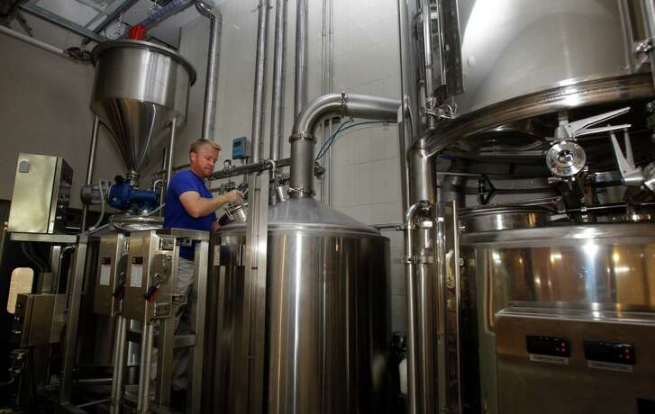 Dave Ohmer, brewmaster, works the brew house at Whole Foods Market.
