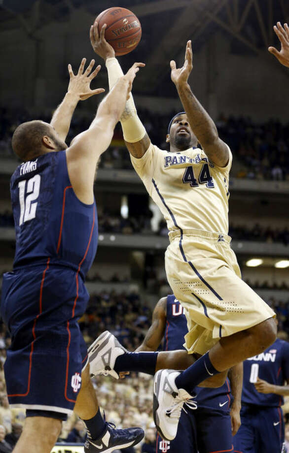 Pittsburgh's J.J. Moore (44) tries to shoot over Connecticut's R.J. Evans (12) during the first half of an NCAA college basketball game, Saturday, Jan. 19, 2013, in Pittsburgh. (AP Photo/Keith Srakocic)