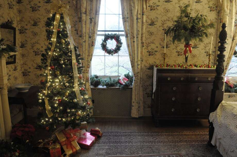A view of one of the decorated upstairs bedrooms  in Albany, NY during the Holiday Tea   at Ten Broeck Mansion on Sunday, Dec. 12, 2010.  The yearly event is put on by the Albany County Historical Association, which operates the Mansion.  Because of the popularity of the event this year the Association held two sittings on Sunday.  The rooms in the mansion are decorated for the holidays by area groups.  This Thursday, Dec. 16th at 7pm, the Associate will hold Christmas Traditions at the mansion, a Italian holiday event of caroling and cookies and cakes.  On Saturday, Dec. 18th, the Association will hold the Holiday Madrigals event from 2pm - 4:30pm, and a children's story time from 10:30am till 12 noon.    (Paul Buckowski / Times Union) Photo: Paul Buckowski, Albany Times Union