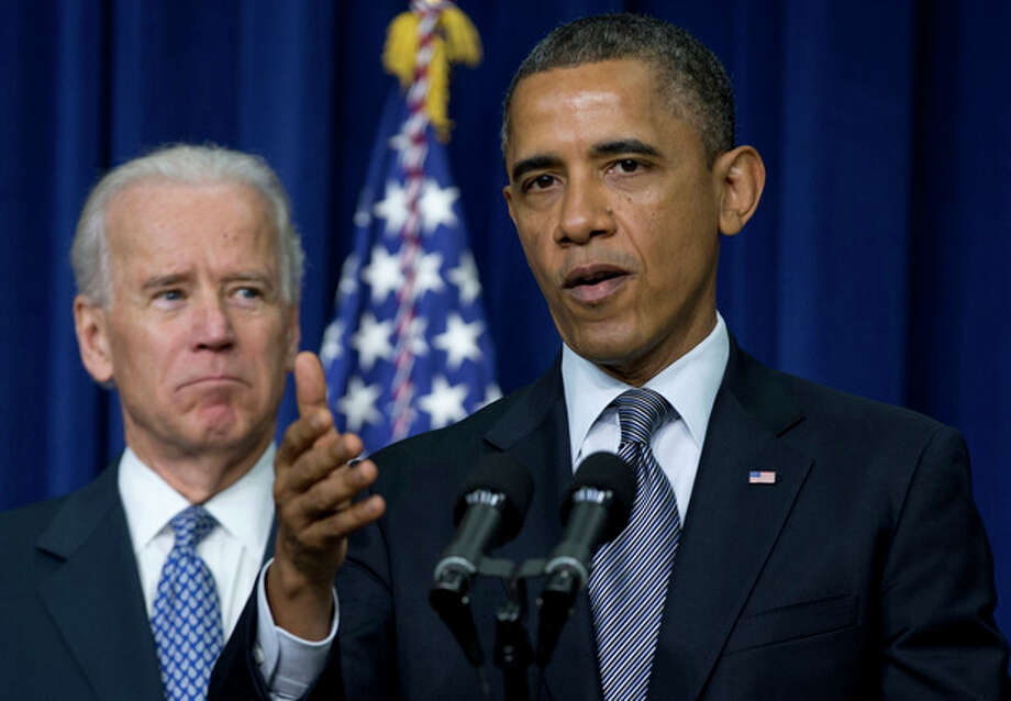 FILE - This Jan. 16, 2013 file photo shows President Barack Obama, accompanied by Vice President Joe Biden, gesturing as he talks about proposals to reduce gun violence, in the South Court Auditorium at the White House in Washington. Supporters of President Barack Obama's gun control plans are plotting a methodical, state-by-state campaign to try to persuade key lawmakers that it's in their political interest to back new restrictions. To do that, they have to overcome two decades of conventional wisdom that gun control is bad politics _ and the National Rifle Association is confident its supporters will prevail. (AP Photo/Carolyn Kaster, File) / AP