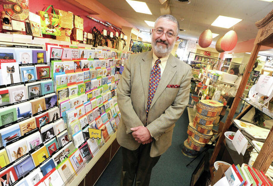 Hour photo / Matthew VinciKurt R. Spatta, owner of The Card Cupboard, stands in his store, which will close by the end of May.