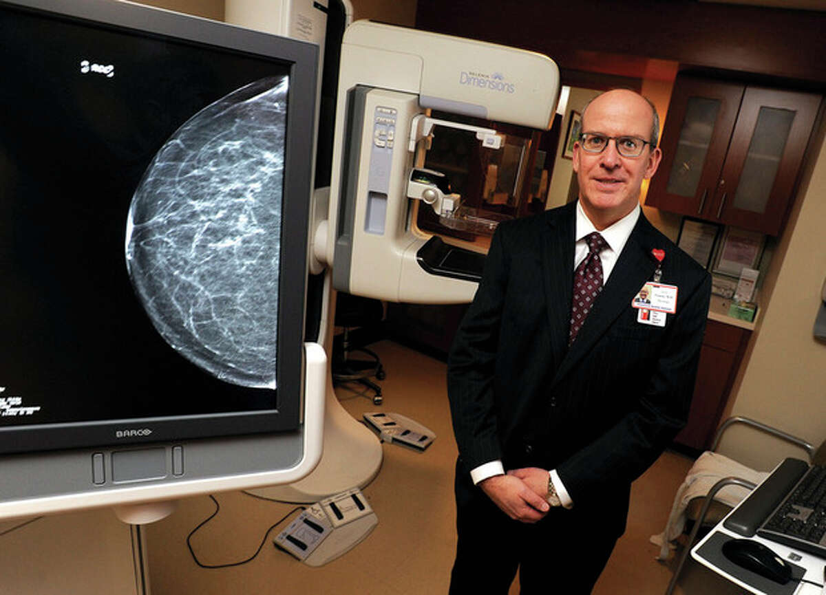 Hour photo / Matthew Vinci Dr. David R. Gruen at Stamford Hospital with the only 3D mammography screening technology in the area.