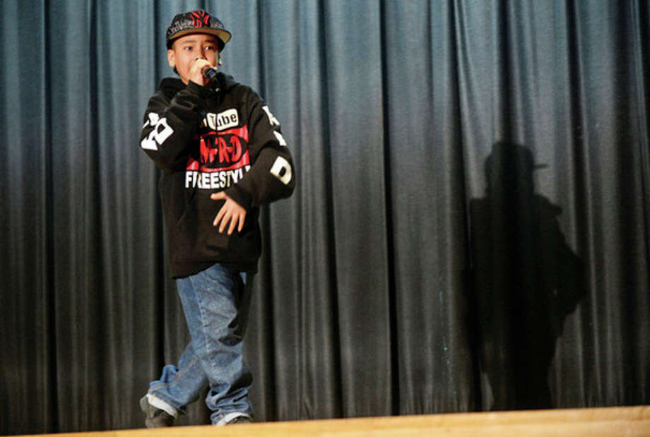 Rapper MRD (aka Destin Brown) sings Jake during the Trailblazer Academy's MLK Day of Service in Stamford Saturday.Hour photo / Erik Trautmann / (C)2012, The Hour Newspapers, all rights reserved