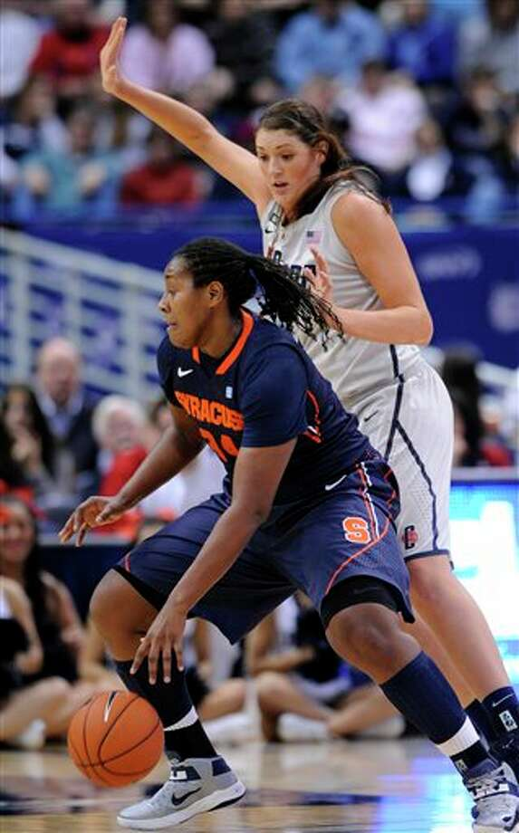 Syracuse's Shakeya Leary, left is guarded by Connecticut's Stefanie Dolson during the first half of an NCAA college basketball game in Hartford, Conn., Saturday, Jan. 19, 2013. (AP Photo/Fred Beckham) / FR153656 AP