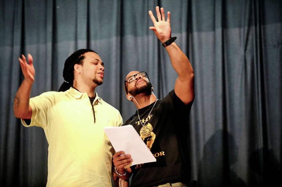 Actors with the troupe Driven 2 Inspire, Andre Armour and Tremaine France , perform during the Trailblazer Academy's MLK Day of Service in Stamford Saturday.Hour photo / Erik Trautmann / (C)2012, The Hour Newspapers, all rights reserved