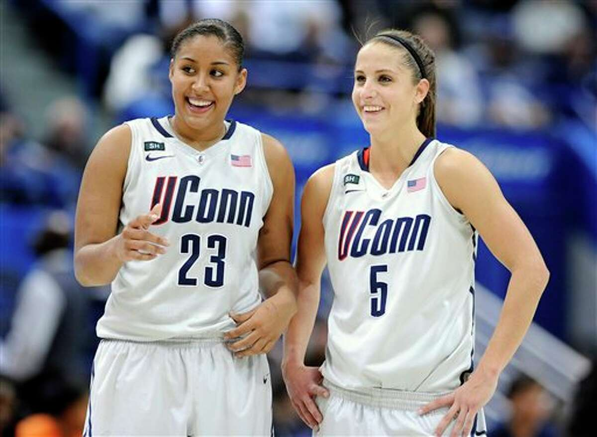Connecticut's Kaleena Mosqueda-Lewis, left and Caroline Doty smile late in the second half of their 87-62 victory over Syracuse in an NCAA college basketball game in Hartford, Conn., Saturday, Jan. 19, 2013. Mosqueda-Lewis scored a game-high 25 points in the win.(AP Photo/Fred Beckham)