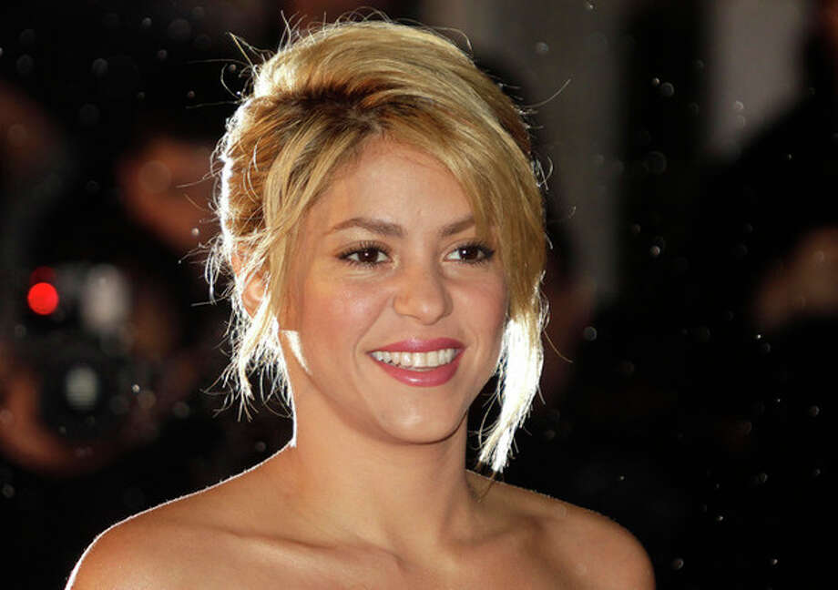 FILE - This Jan. 28, 2012 file photo shows Colombian singer Shakira arriving at the Cannes festival palace, to take part in the NRJ Music awards ceremony, in Cannes, southeastern France. A spokesman for the 35-year-old Columbian singer says Shakira Mebarak and 25-year-old soccer star Gerard Pique of FC Barcelona welcomed son Milan Pique Mebarak on Tuesday, Jan. 22, 2013, at 9:36 p.m. in Barcelona, Spain. (AP Photo/Lionel Cironneau, file) / AP