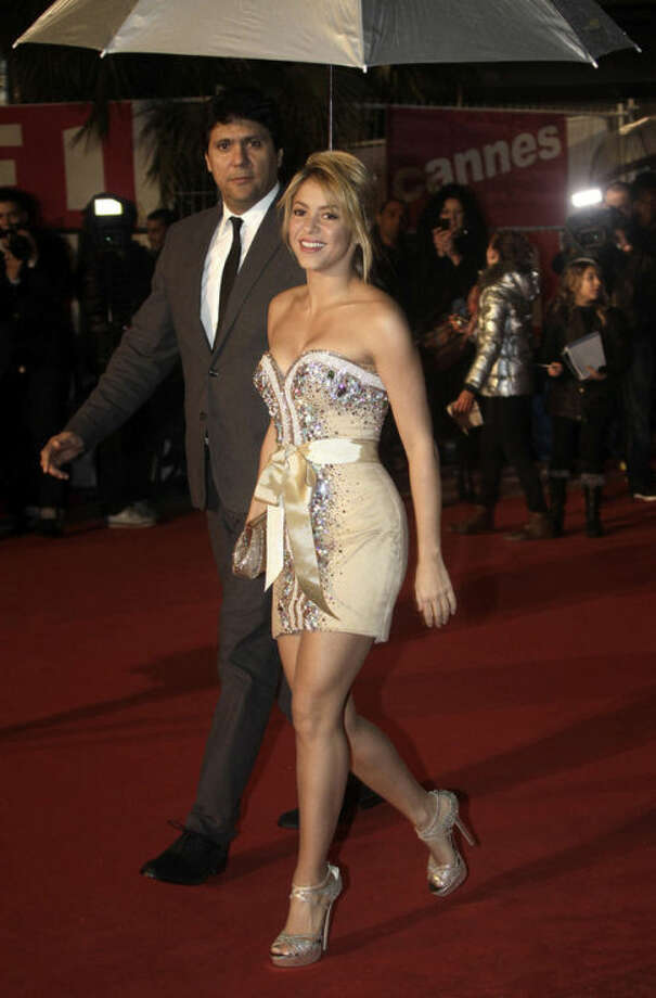 FILE - In this Jan. 28, 2012 file photo, Colombian performer Shakira arrives for the NRJ Music awards ceremony in Cannes, southeastern France. A spokesman for the 35-year-old Columbian singer says Shakira Mebarak and 25-year-old soccer star Gerard Pique of FC Barcelona welcomed son Milan Pique Mebarak on Tuesday, Jan. 22, 2013, at 9:36 p.m. in Barcelona, Spain. (AP Photo/Lionel Cironneau, File)