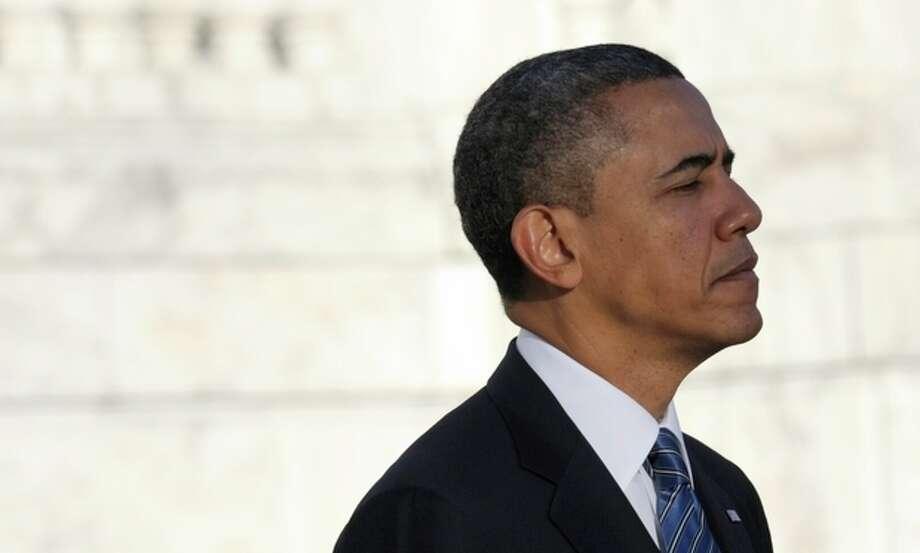 President Barack Obama pauses after placing a wreath at Arlington Cemetery in Arlington, Va., Sunday, Jan. 20, 2013. (AP Photo/Susan Walsh) / AP