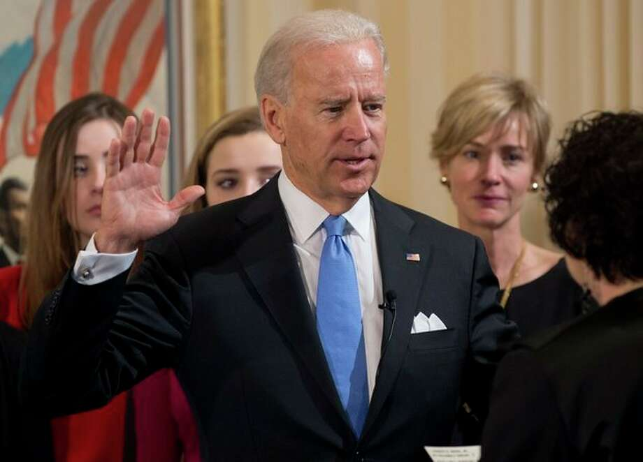 Vice President Joe Biden takes the oath of office during the 57th Presidential Inauguration official swearing-in ceremony at the Naval Observatory on Sunday, January 20, 2013 in Washington. The oath is administered by US Supreme Court Justice Sonia Sotomayor. (AP Photo/Saul Loeb, AFP) / Pool AFP