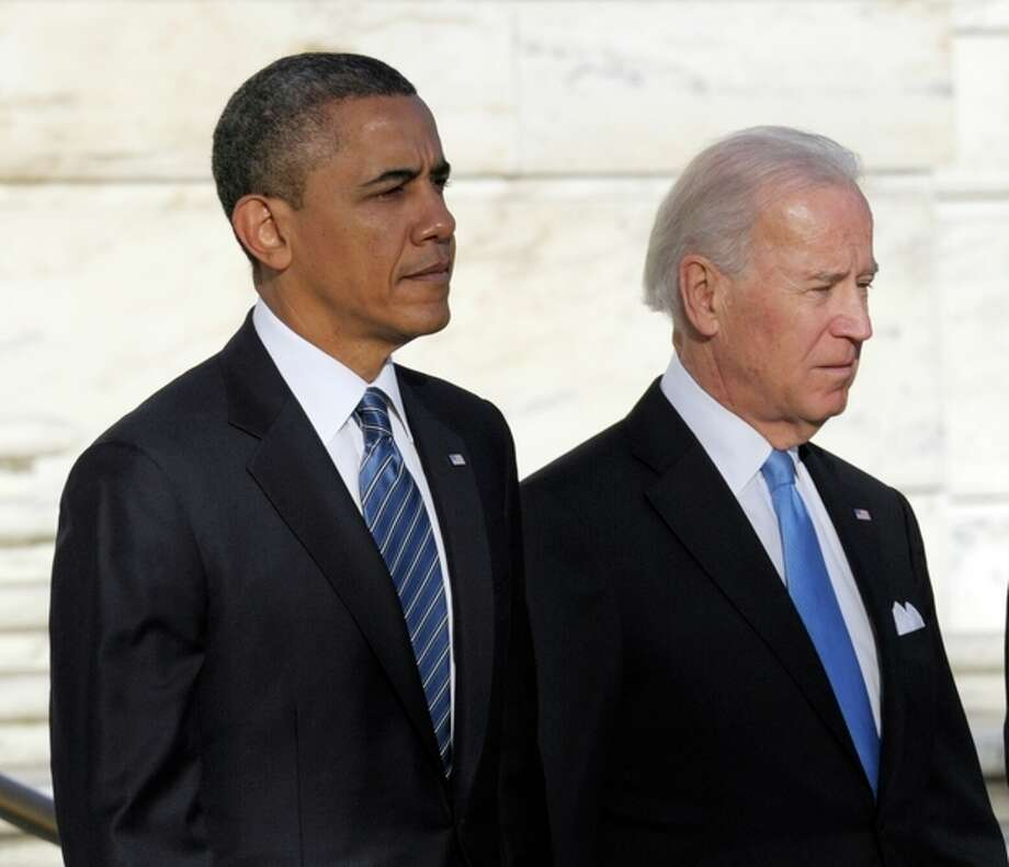 President Barack Obama and Vice President Joe Biden wait to place a wreath at the Tomb of the Unknowns at Arlington National Cemetery in Arlington, Va., Sunday, Jan. 20, 2013. (AP Photo/Susan Walsh) / AP