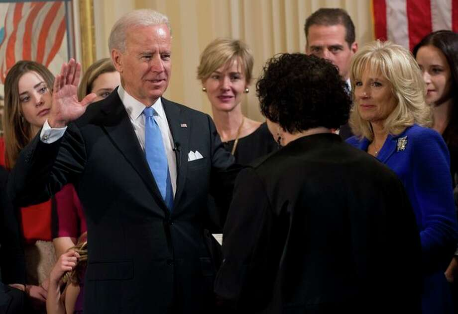Vice President Joe Biden takes the oath of office during the 57th Presidential Inauguration official swearing-in ceremony at the Naval Observatory on Sunday, January 20, 2013 in Washington. The oath is administered by US Supreme Court Justice Sonia Sotomayor as Dr. Jill Biden, right, looks on. (AP Photo/Saul Loeb, Pool) / Pool AFP