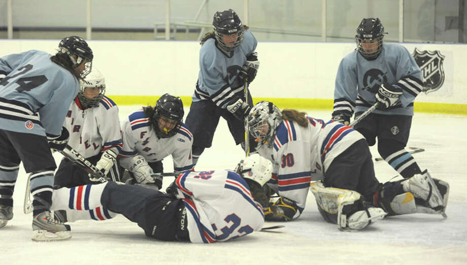 Wilton girls hockey team coming together even as everything seems to fall apart around them
