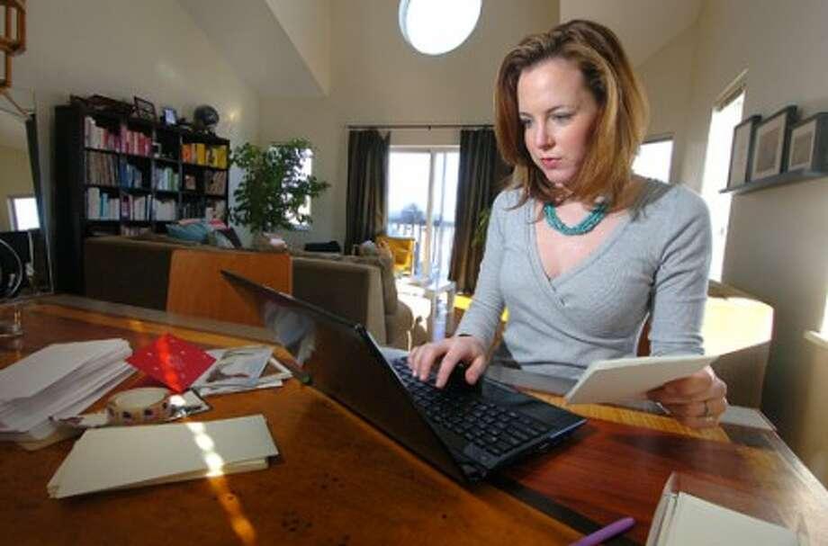 Photo/Alex von Kleydorff. Lauren Fister works on her ''Random Notes of Kindness'' project in her Norwalk home.
