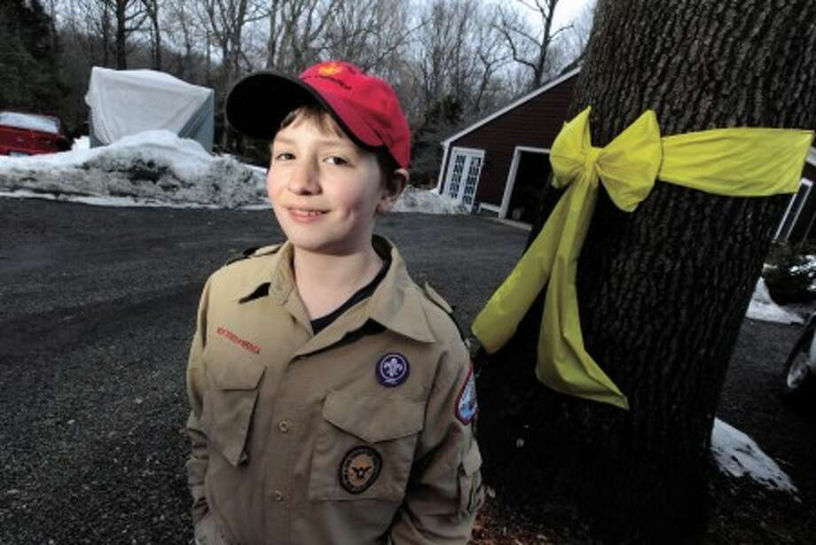 Isaac Reeves of Wilton is a boy scout raising money through collecting cans and bottles for his father''s National Guard unit in Iraq. photo/matthew vinci