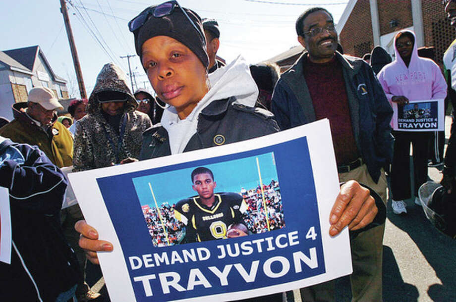 Kimberly McNight marches down South Main in protest over the killing of Travon Martin Saturday during the event organized by the Calvary and Grace Baptist Churches.Hour photo / Erik Trautmann / (C)2011, The Hour Newspapers, all rights reserved