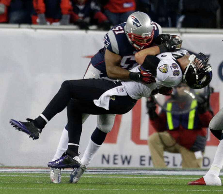 Baltimore Ravens tight end Dennis Pitta (88) is tackled by New England Patriots outside linebacker Jerod Mayo (51) during the second half of the NFL football AFC Championship football game in Foxborough, Mass., Sunday, Jan. 20, 2013. (AP Photo/Elise Amendola) / AP