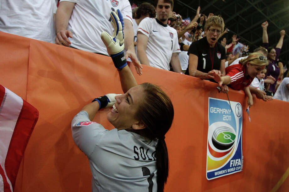 United States goalkeeper Hope Solo celebrates winning the quarterfinal match between Brazil and the United States at the WomenÕs Soccer World Cup in Dresden, Germany, Sunday, July 10, 2011. (AP Photo/Marcio Jose Sanchez) / AP
