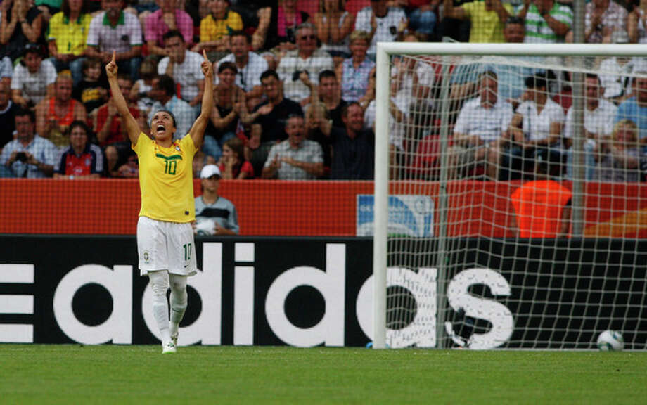 Brazil's Marta reacts after scoring her side's second goal during the quarterfinal match between Brazil and the United States at the WomenÕs Soccer World Cup in Dresden, Germany, Sunday, July 10, 2011. (AP Photo/Petr David Josek) / AP